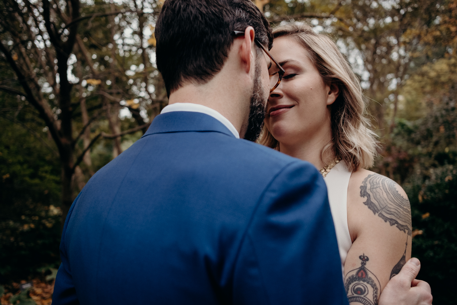couple holds each other during wedding portraits at dc wedding