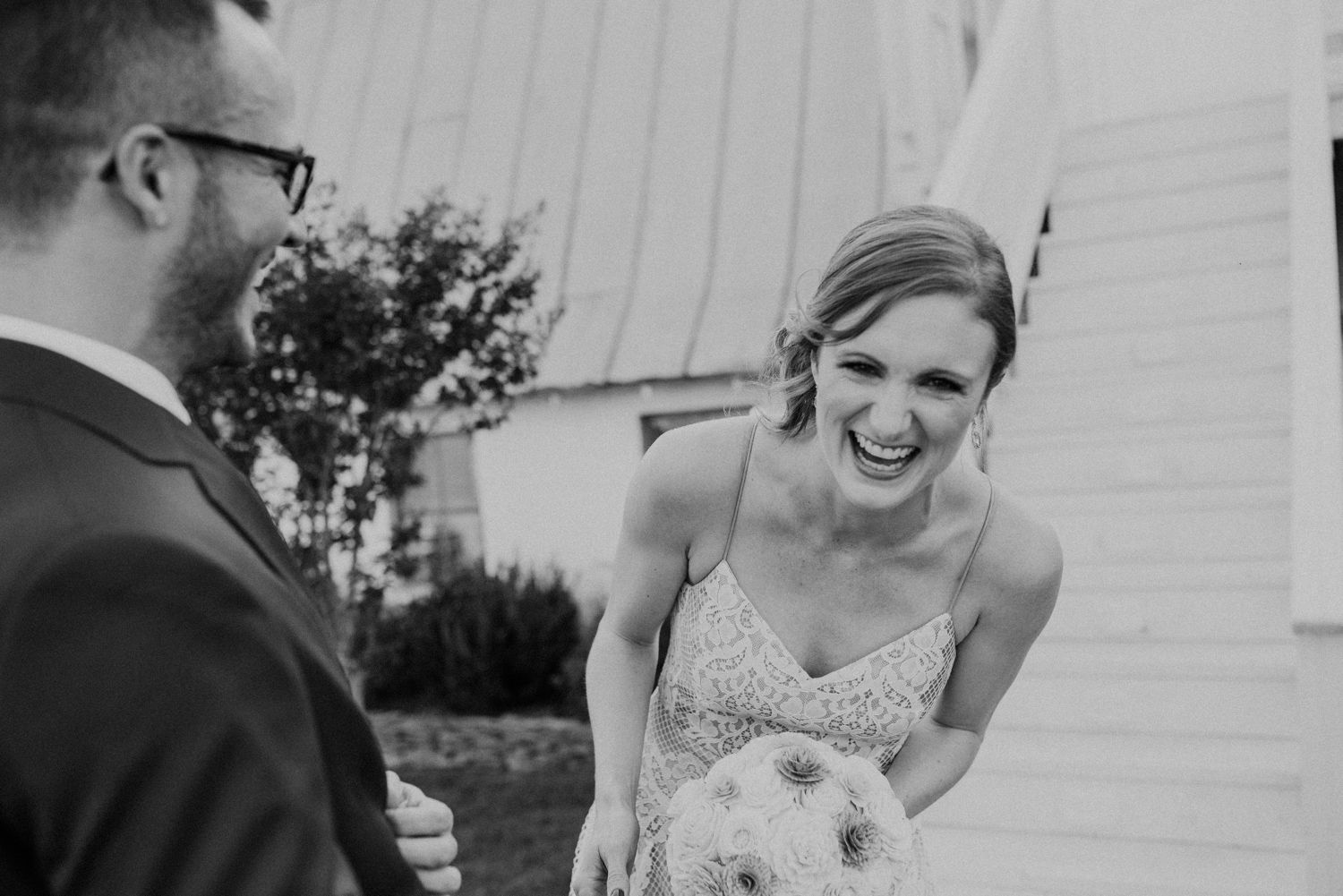 Bride and groom laugh during First Look