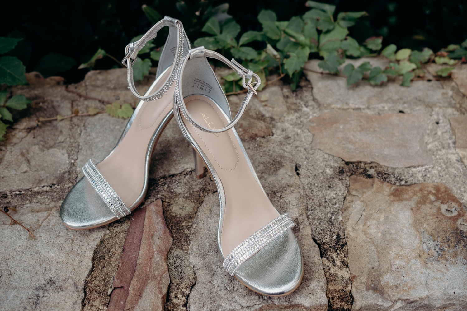 bride's shoes on stone wall at salamander resort in middleburg va