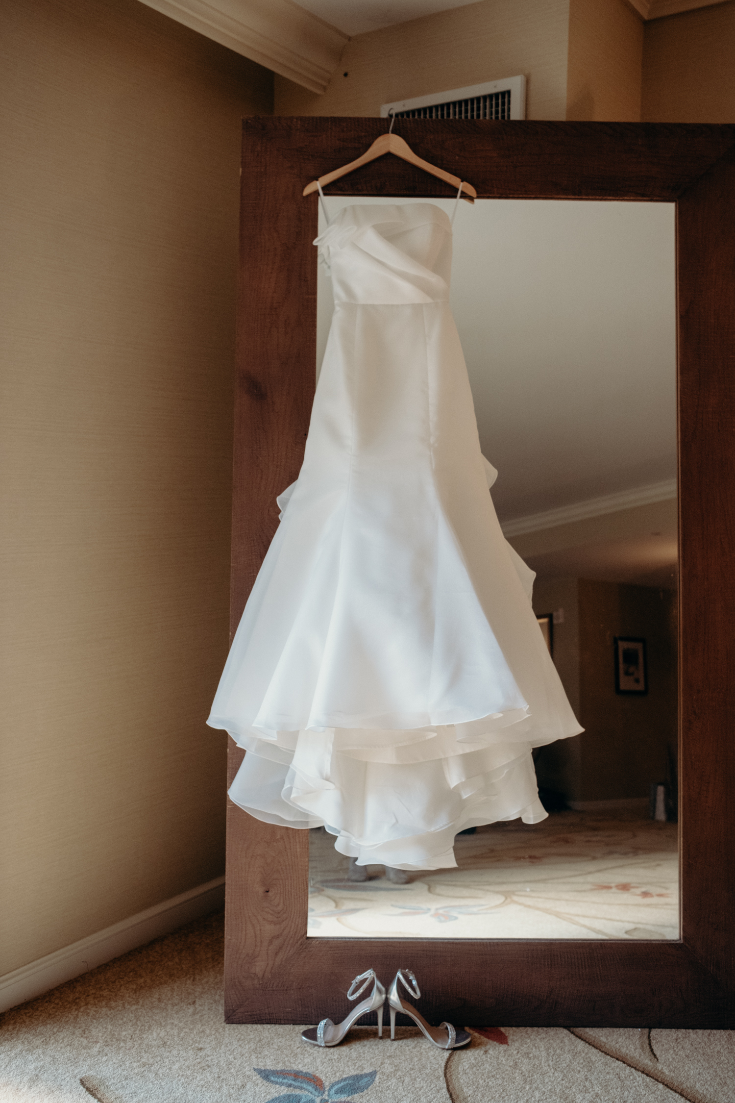salamander resort bride's dress hanging on mirror