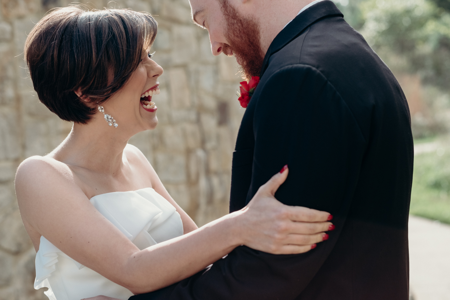 bride and groom laugh in delight as they see each other during their First Look at Virginia wedding