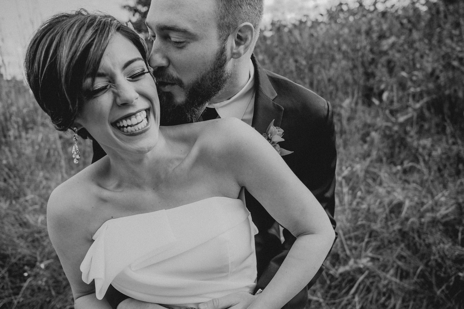 groom kisses his bride during emotional first look