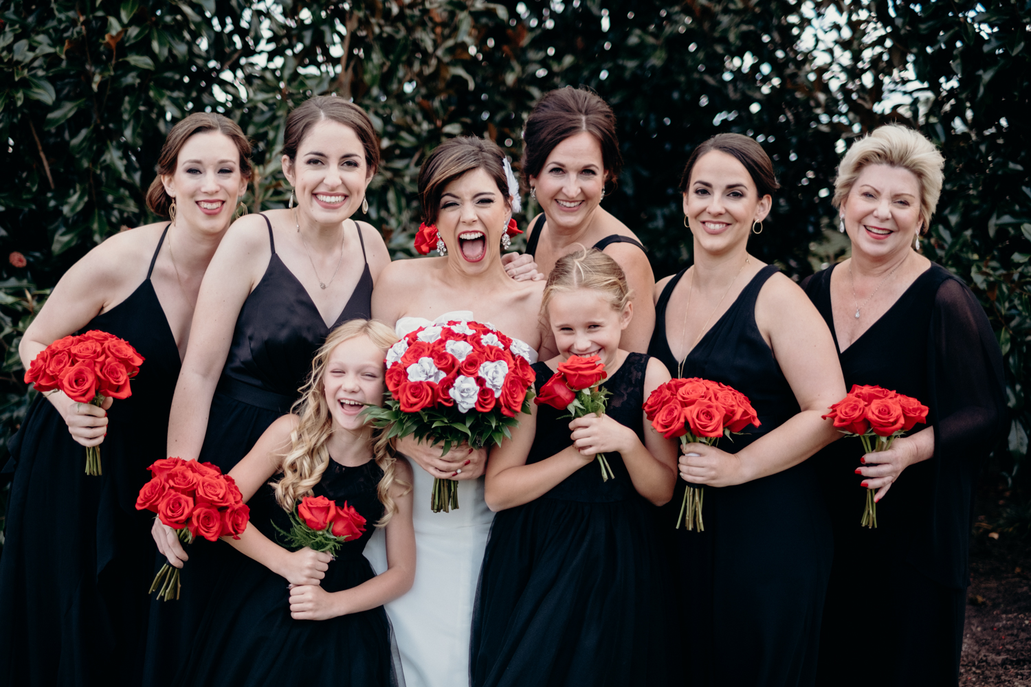 bridesmaids pose and laugh for portraits