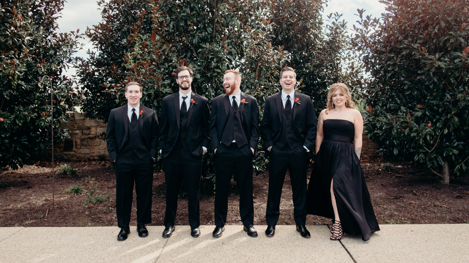 groomsmen pose and laugh for portraits