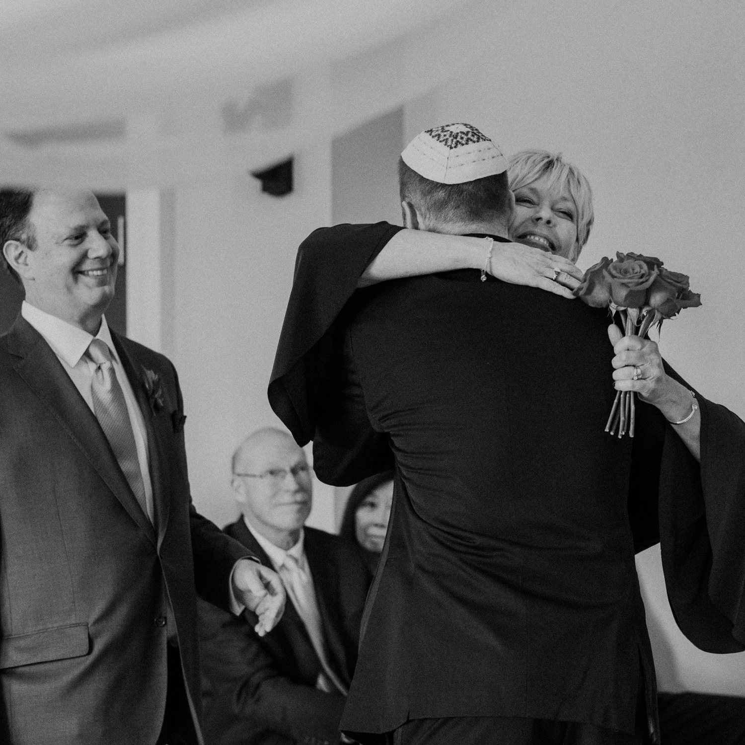 Mother hugs the groom at start of middleburg wedding ceremony