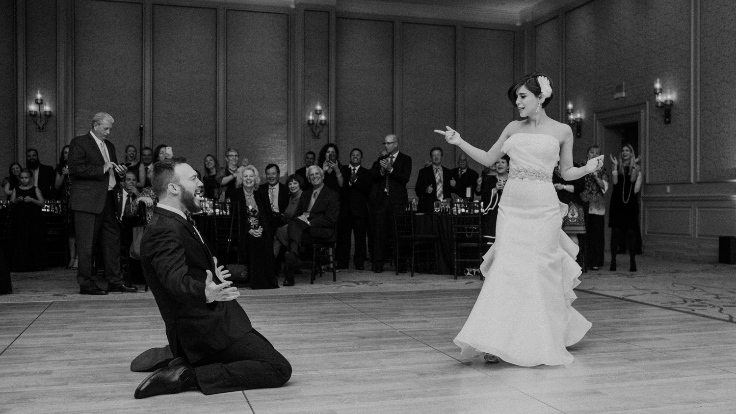 groom slides across dance floor during first dance at salamander resort
