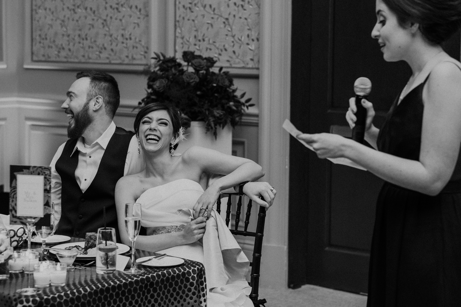bride laughs during maid of honor toast at salamander resort wedding