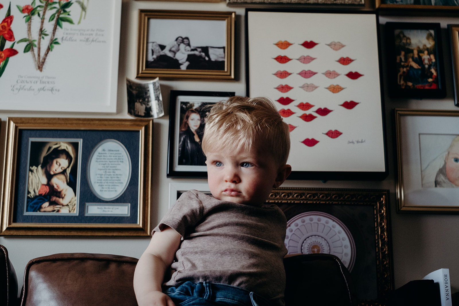 A little boy stands on a couch in his family apartment in Washington, DC.