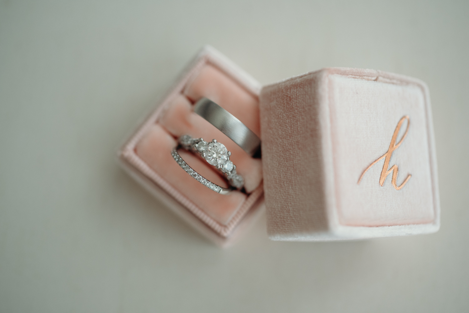 Weddings rings are held in a soft pink box for the bride and groom on their wedding day.