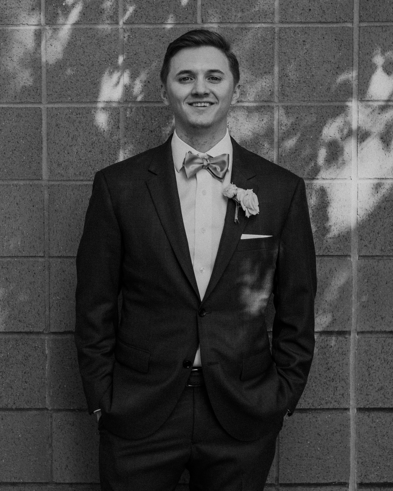 A groom smiles at the camera before his wedding at Lansdowne Resort.
