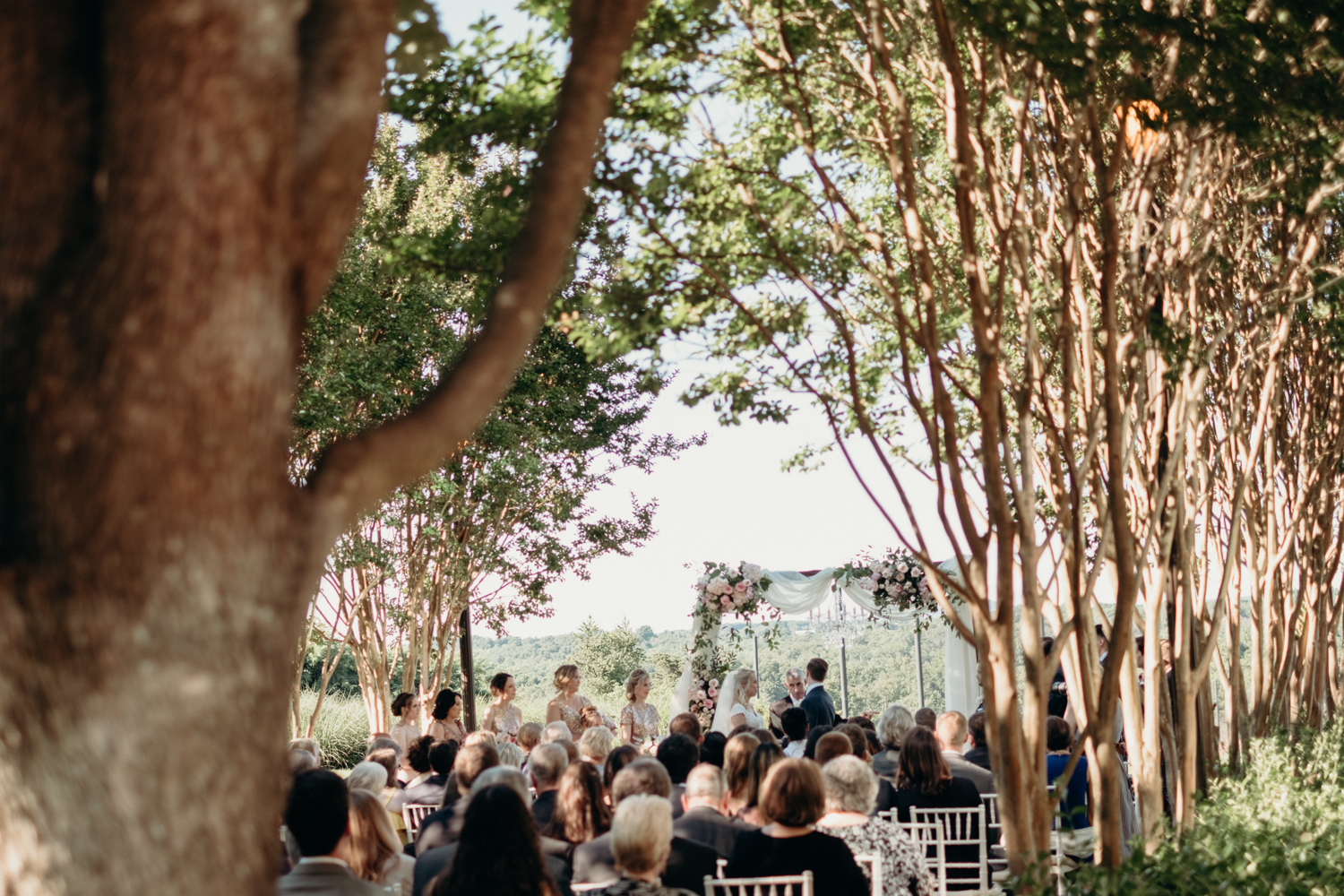 A wedding ceremony is celebrated on the tree-lined patio at Lansdowne Resort.