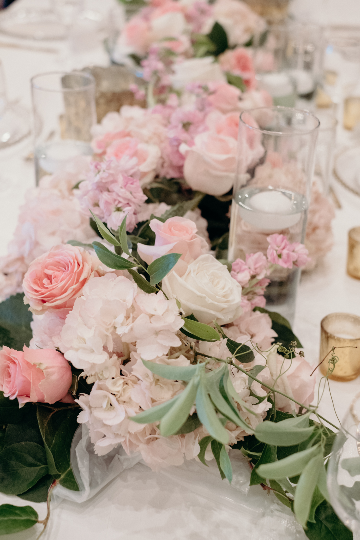 A table is decorated with pink and white flowers at a wedding reception at Lansdowne Resort.