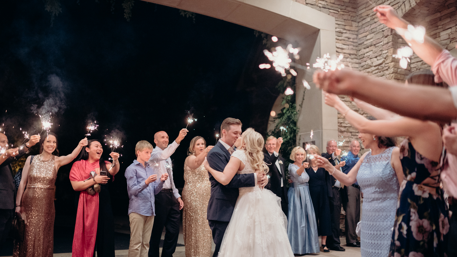 A bride and groom share a kiss during their sparkler exit after their wedding reception at Lansdowne Resort.