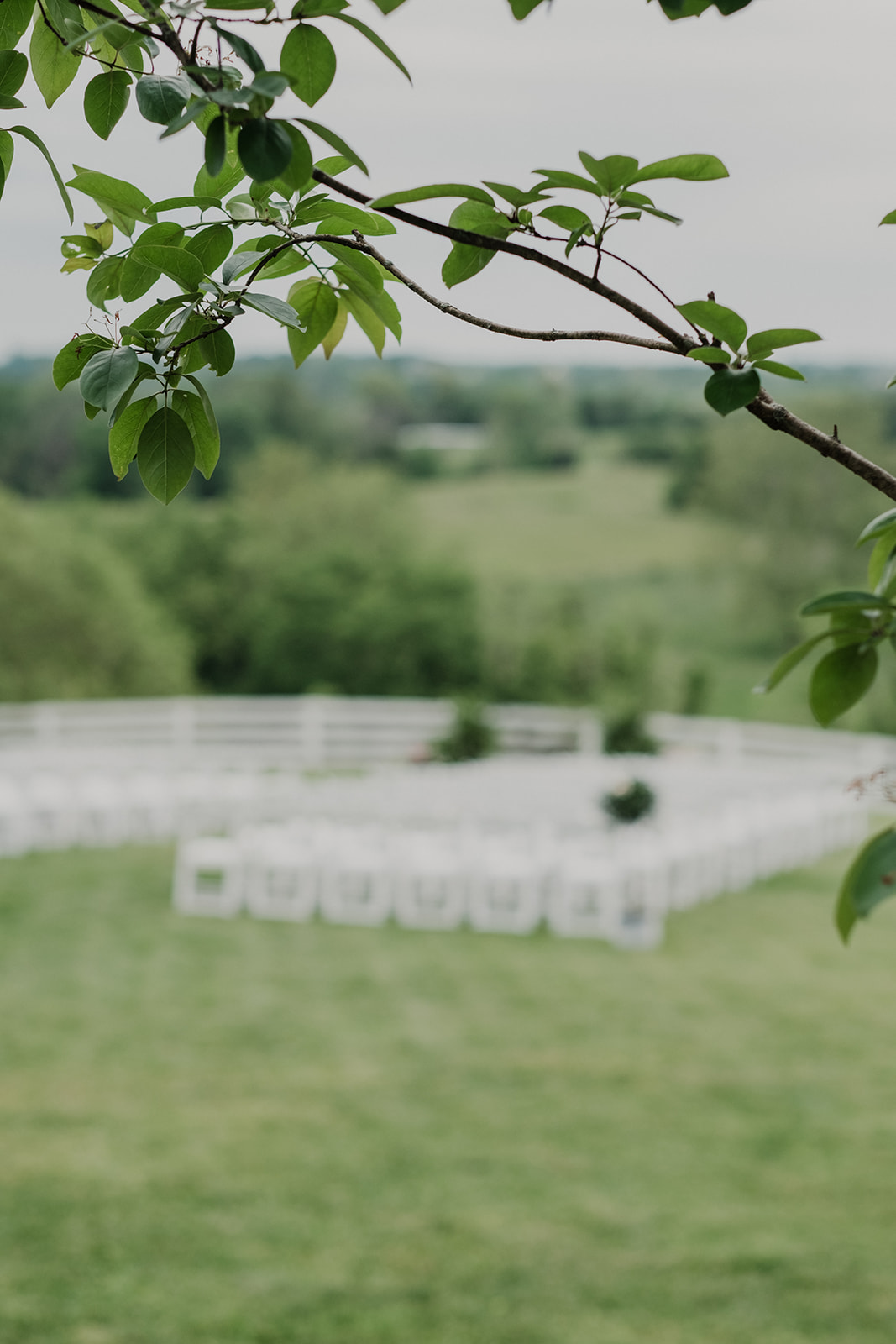 Chairs are set up for an outdoor spring wedding ceremony at Blue Hill Farm in Waterford, VA.