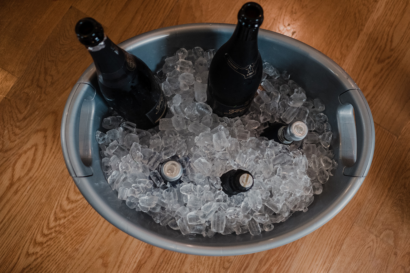 Champagne sits on ice in a galvanized bucket in the getting ready room at Blue Hill Farm in Waterford, VA.