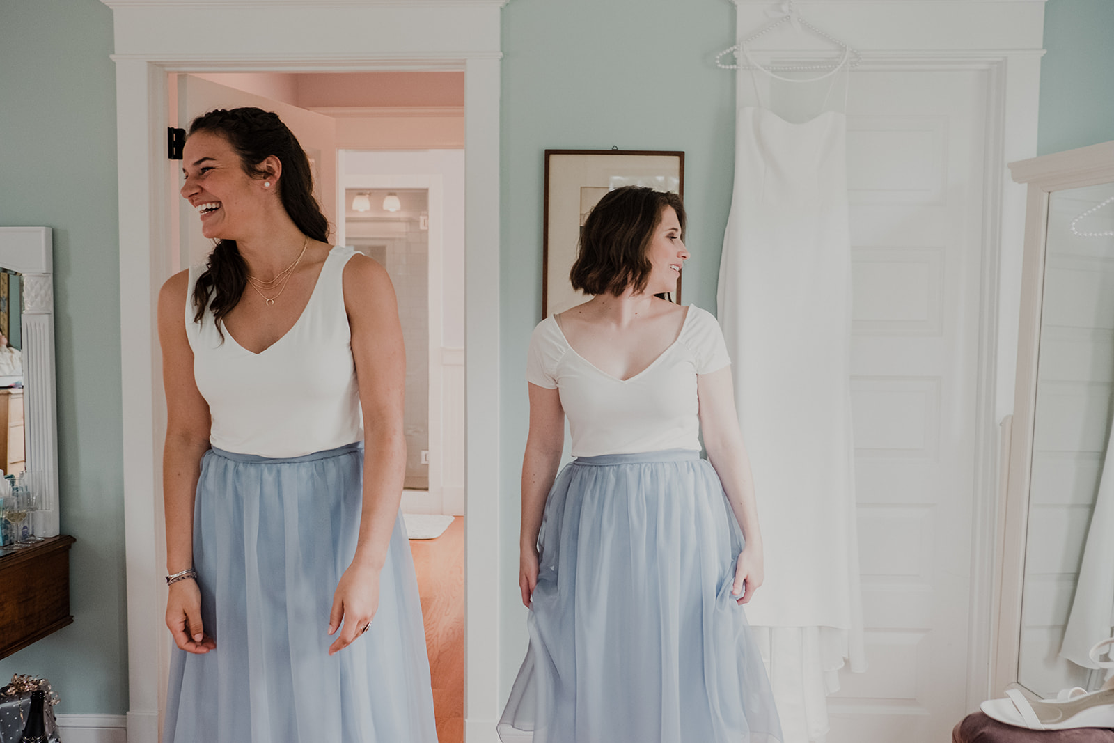 Bridesmaids in cream tops and blue tulle skirts take a moment before the outdoor wedding ceremony at Blue Hill Farm in Waterford, VA.