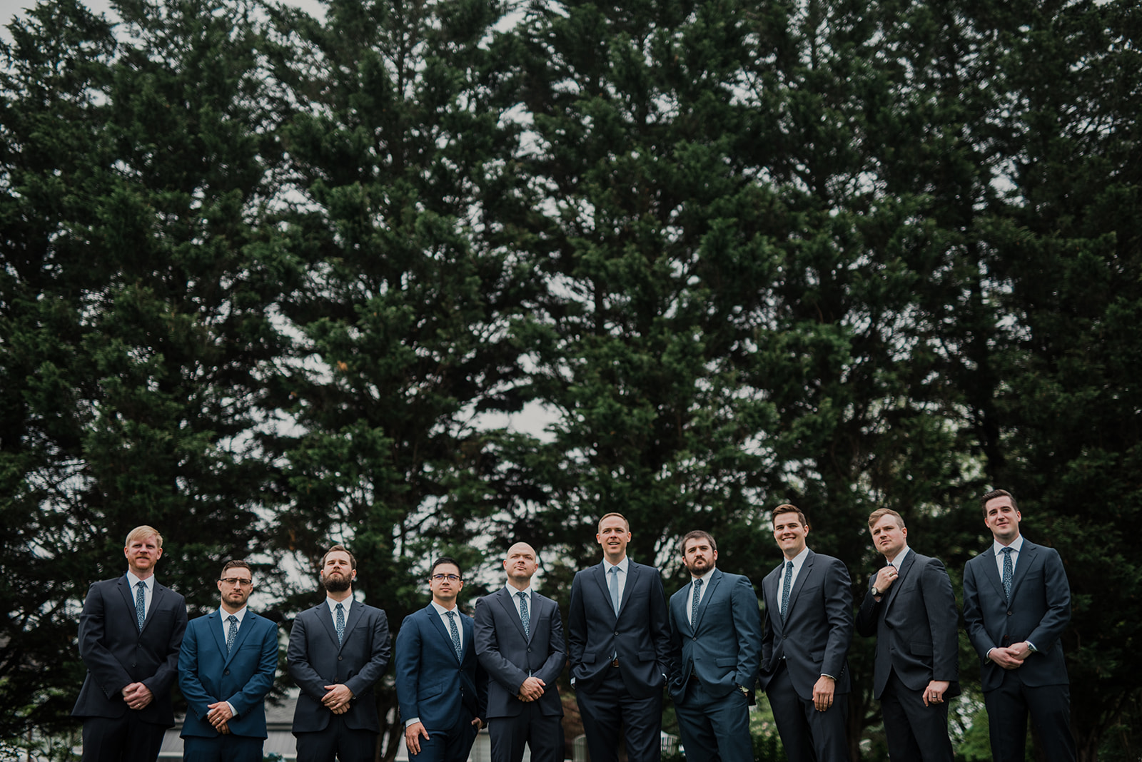 The groomsmen gather together before an outdoor wedding ceremony at Blue Hill Farm in Waterford, VA.