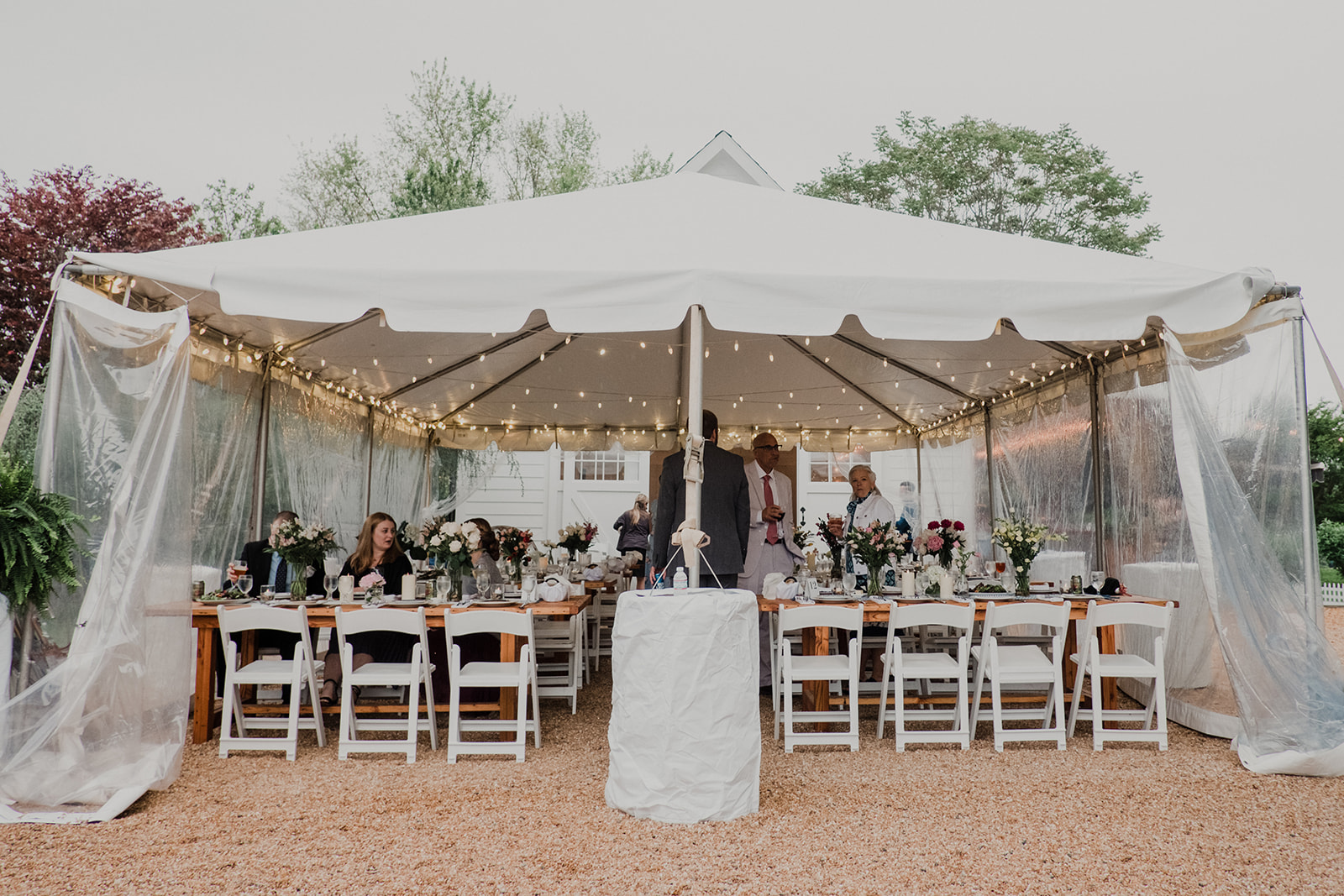 A tent is set up for a wedding reception at Blue Hill Farm in Waterford, VA.