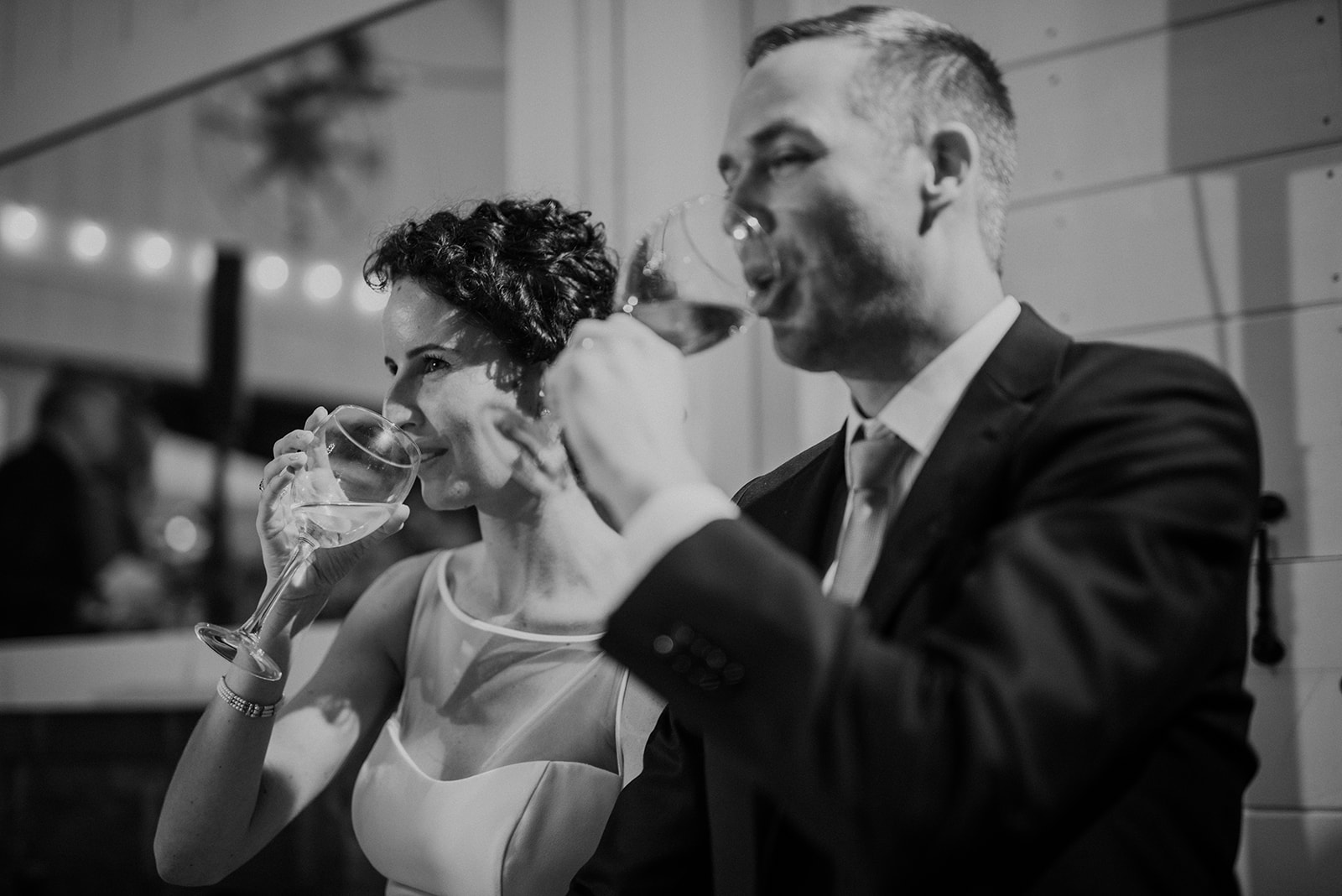 A bride and groom sip champagne after the toasts at their reception at Blue Hill Farm in Waterford, VA.