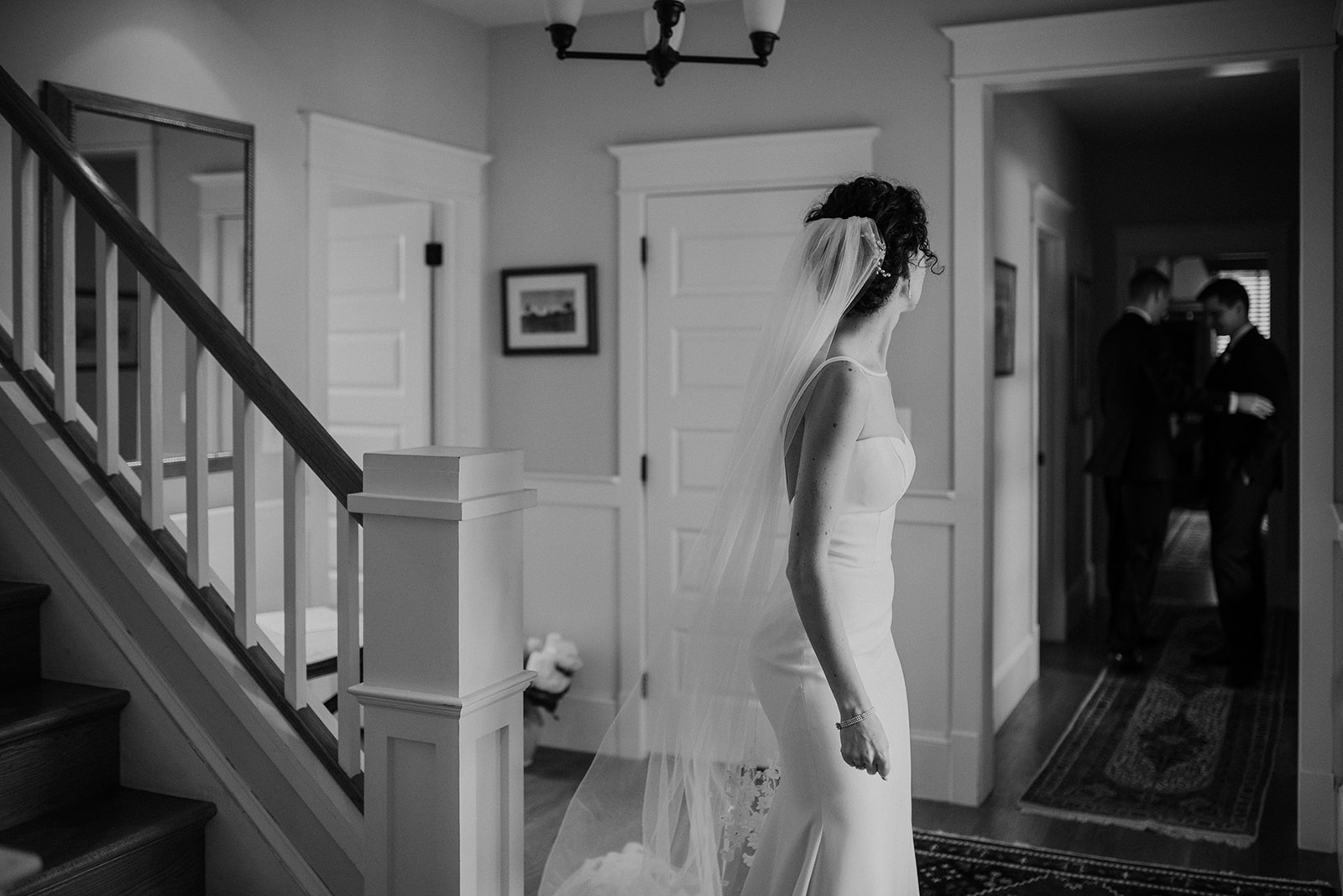 A bride looks back at her groom before he goes to walk down the aisle at their outdoor wedding ceremony at Blue Hill Farm in Waterford, VA.