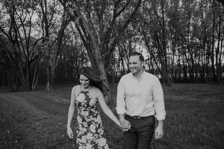 Vanish brewery engagement couple walking through the woods