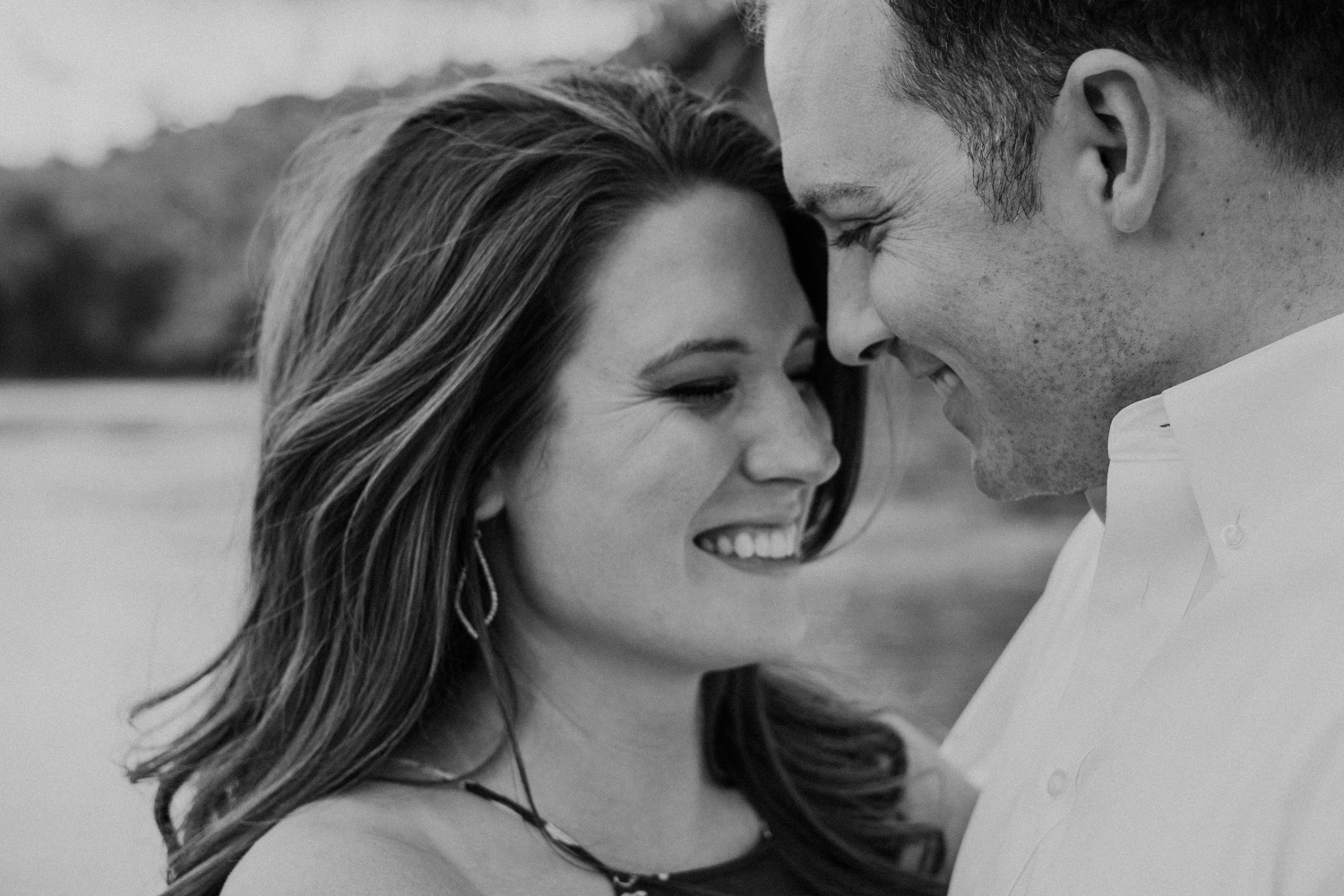 Engagement session couple gets close alongside the Potomac in Maryland