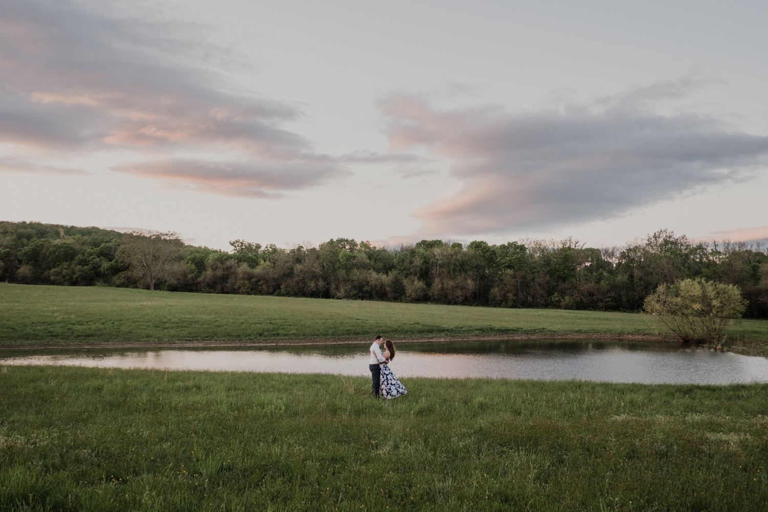 Morven Park engagement couple standing next to a pond at sunset