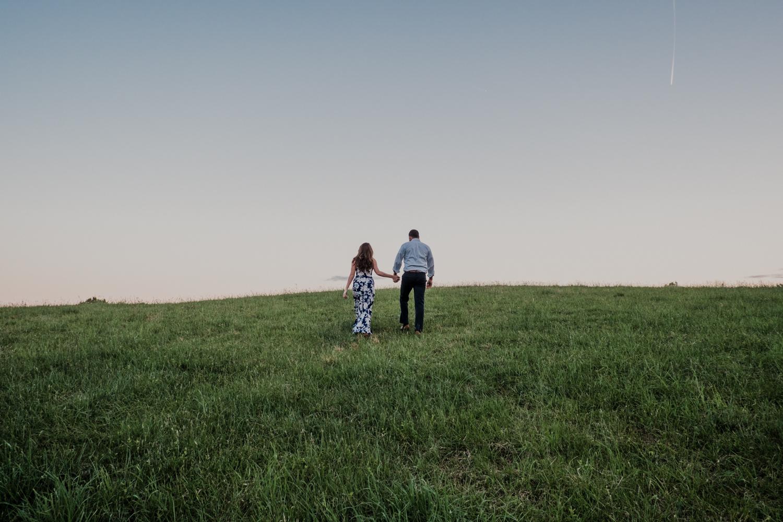Morven Park adventure engagement session couple climbing hill