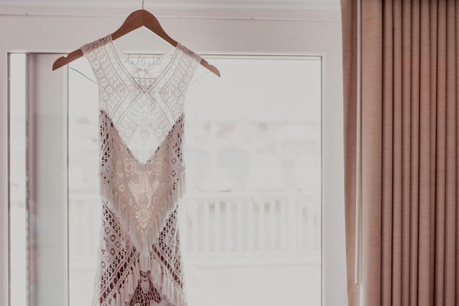gorgeous rue de seine dress hanging in hotel room before wedding