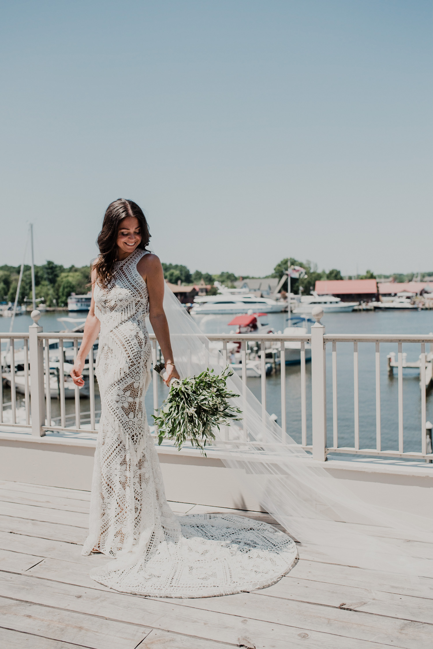 gorgeous bridal portrait on hotel balcony with water and chesapeake bay maritime museum in the background