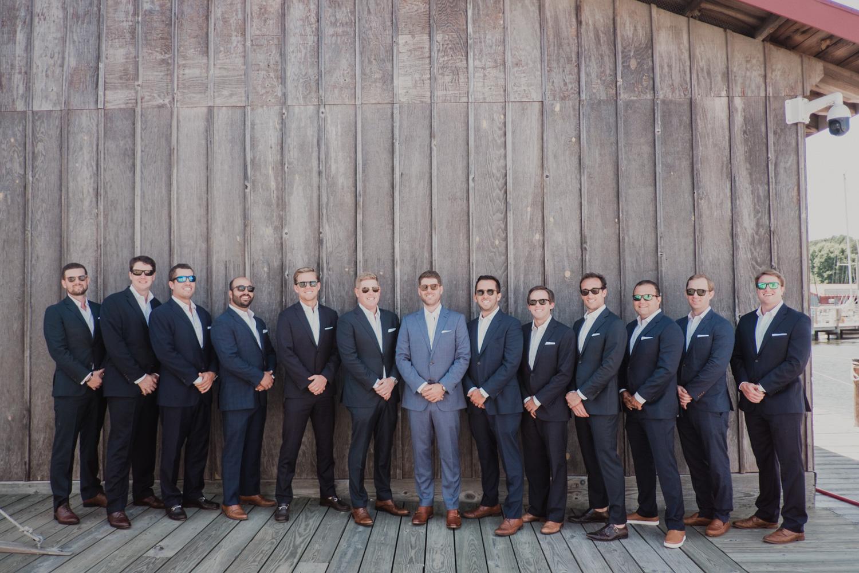 groomsmen portrait on the docks at chesapeake bay maritime museum
