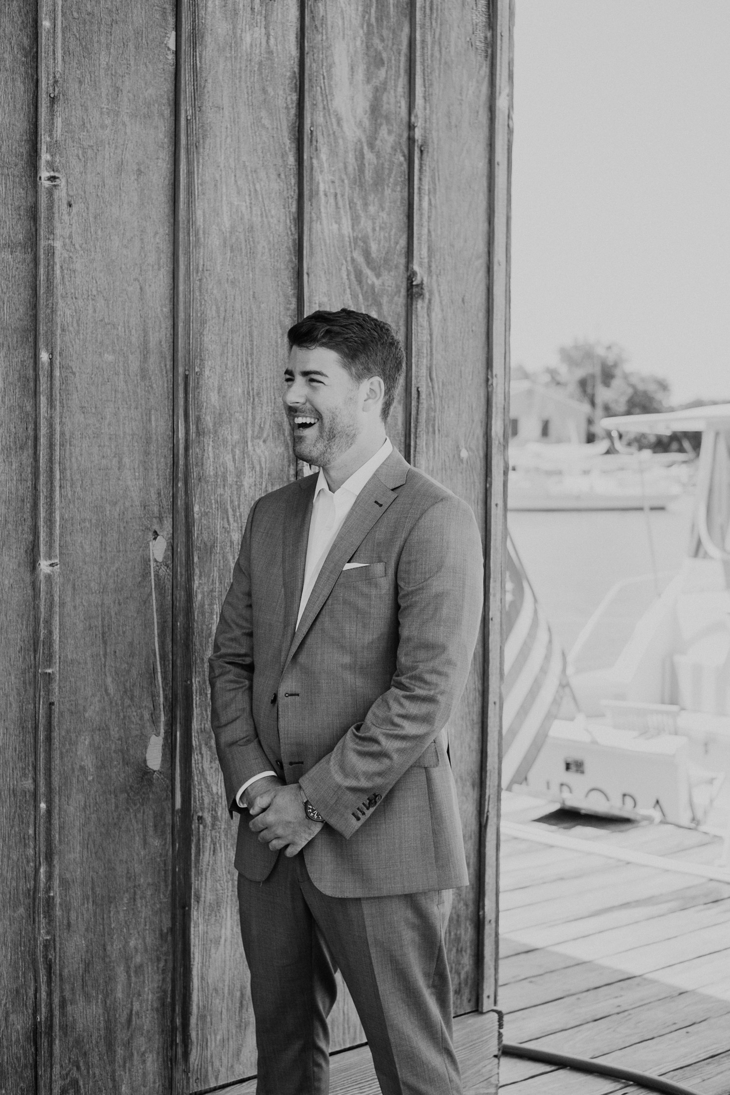 groom smiles big as he sees his bride during first look