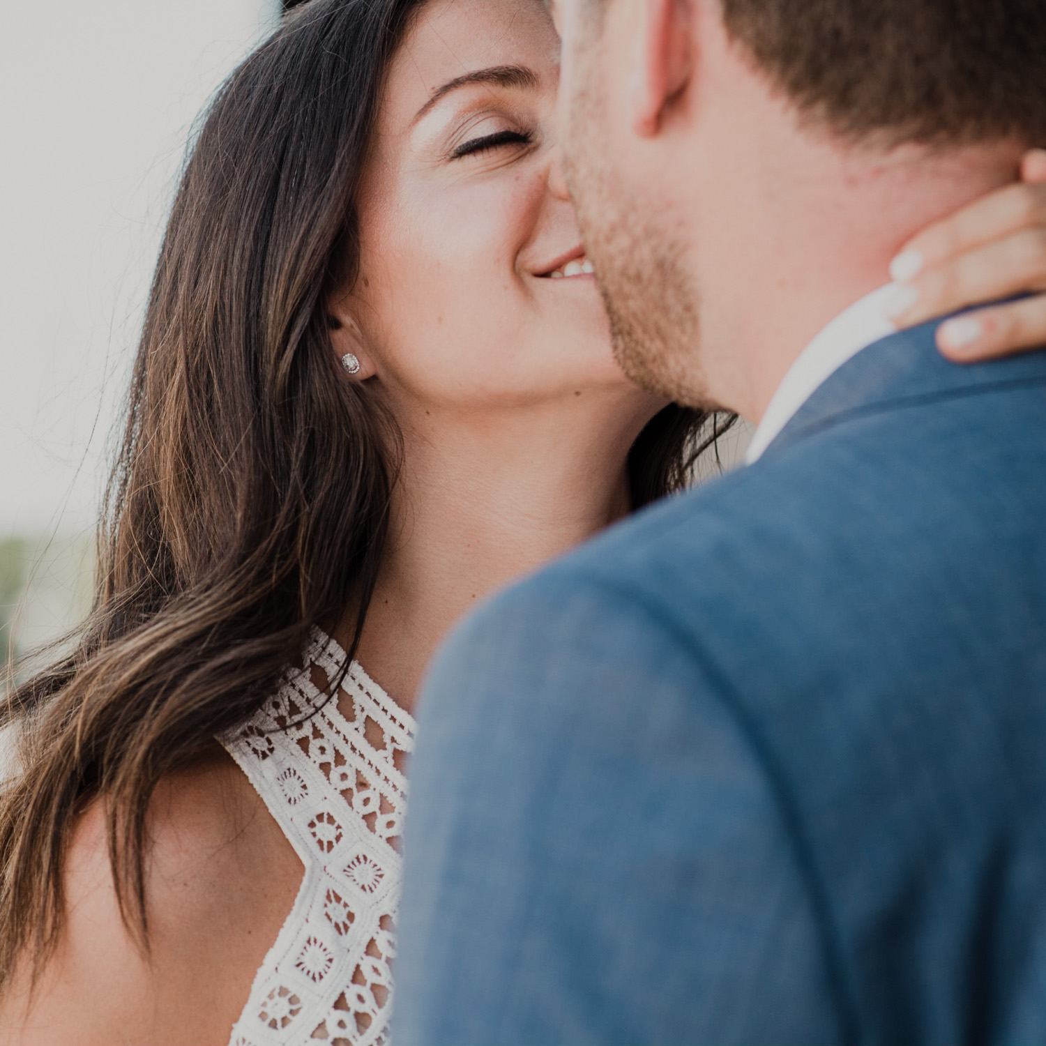 bride kisses groom during first look embrace