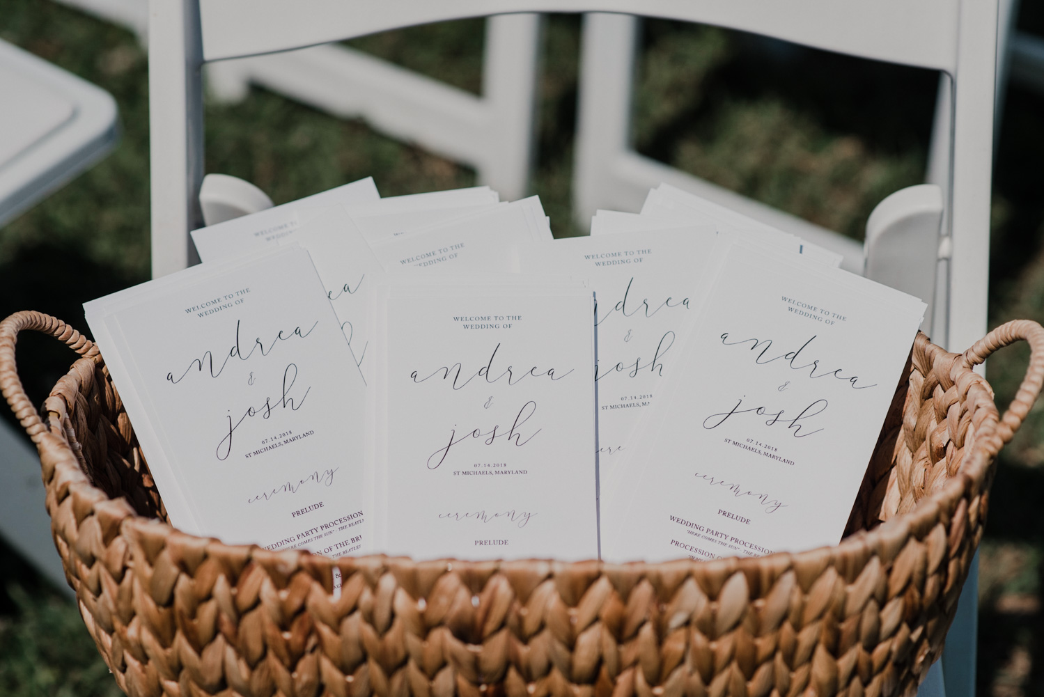 bride and groom's wedding programs in a basket for guests