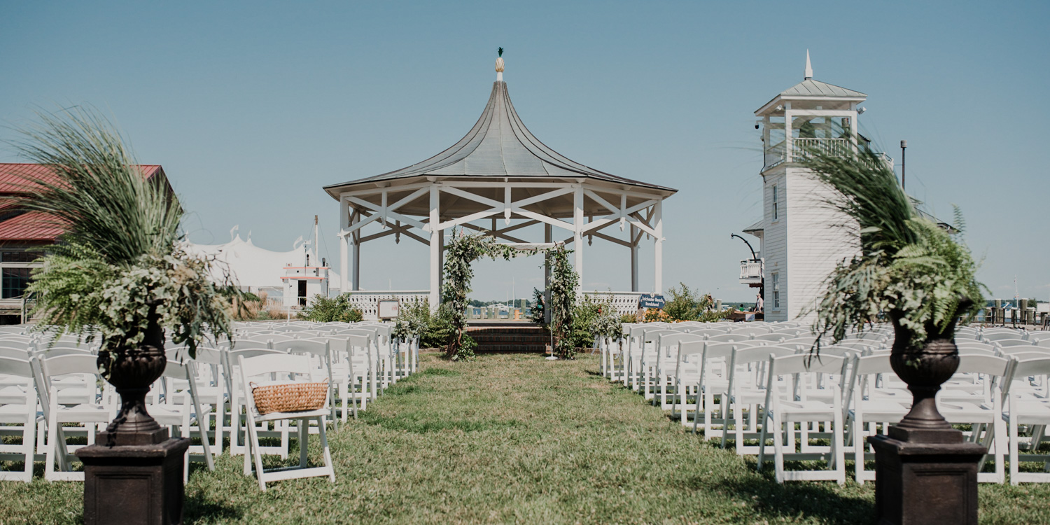 chesapeake bay maritime museum ceremony views with beautiful greenery accents and chuppah