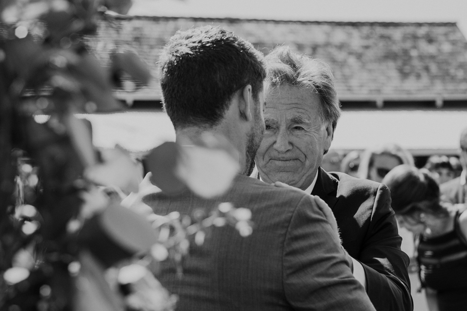 groom shakes bride's father's hand at the start of wedding ceremony