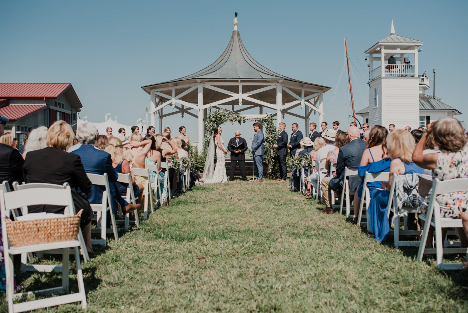 wedding ceremony at chesapeake bay maritime museum on a bright and sunny day