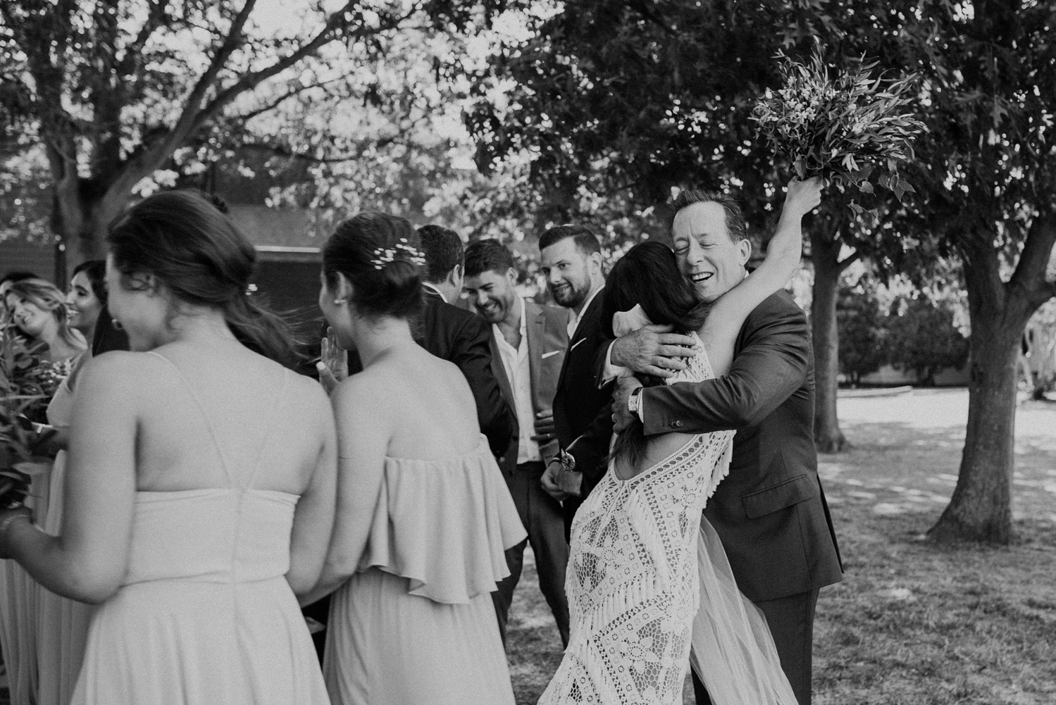 bride embraces her new father-in-law at the end of the wedding ceremony