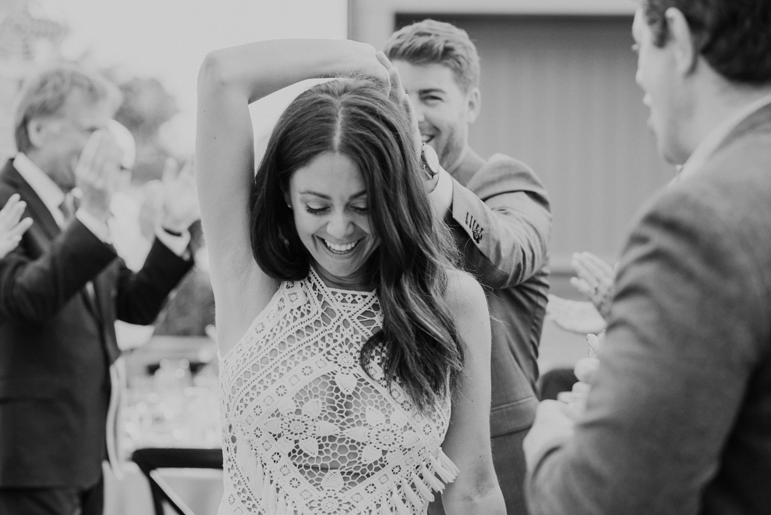 bride leads groom into reception during entrance