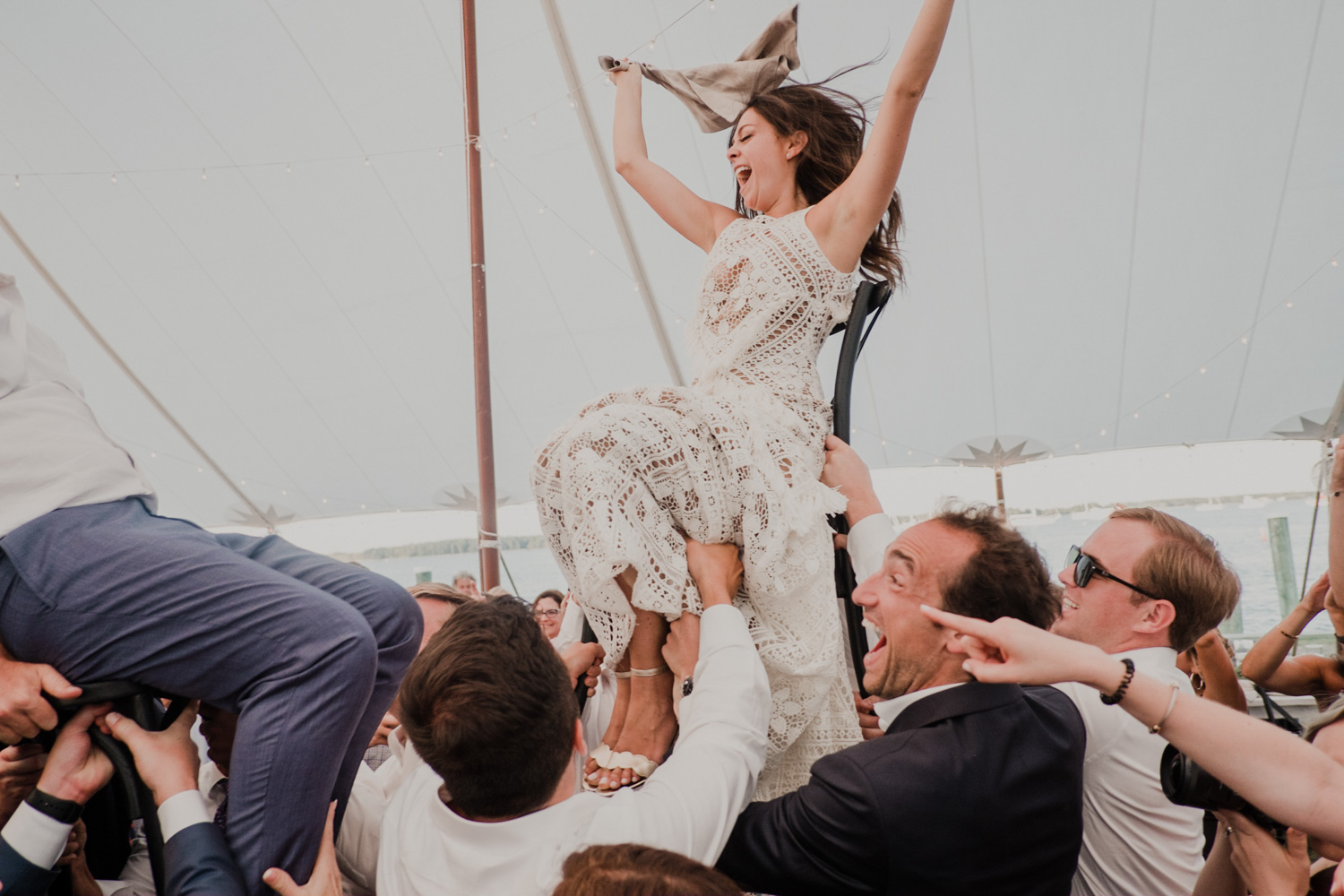 bride is raised in the air during the hora