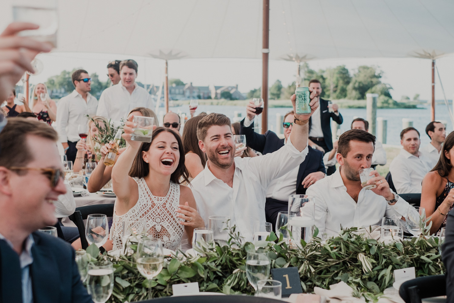 bride and groom raise their glasses during best man toast