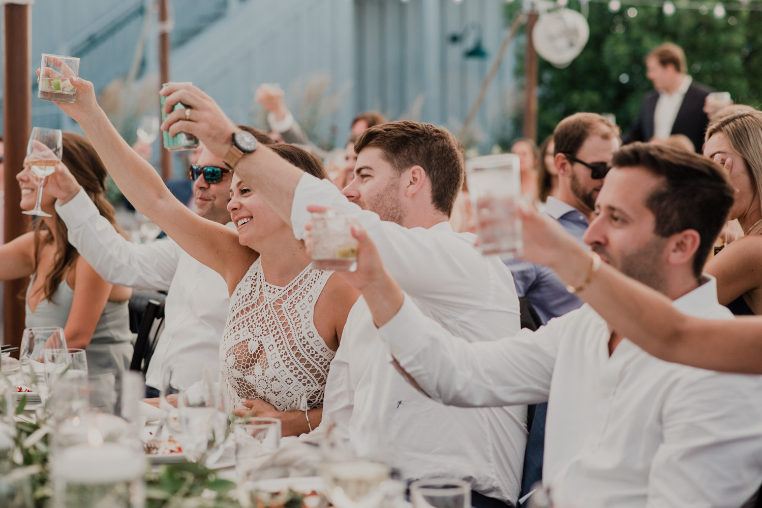 wedding guests cheers during toasts