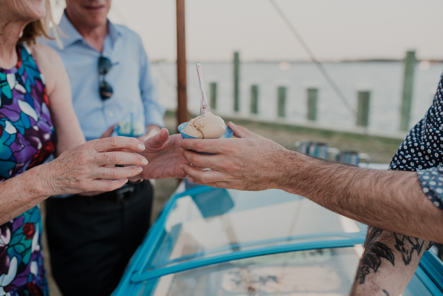 scottish highland creamery hands ice cream to wedding guest