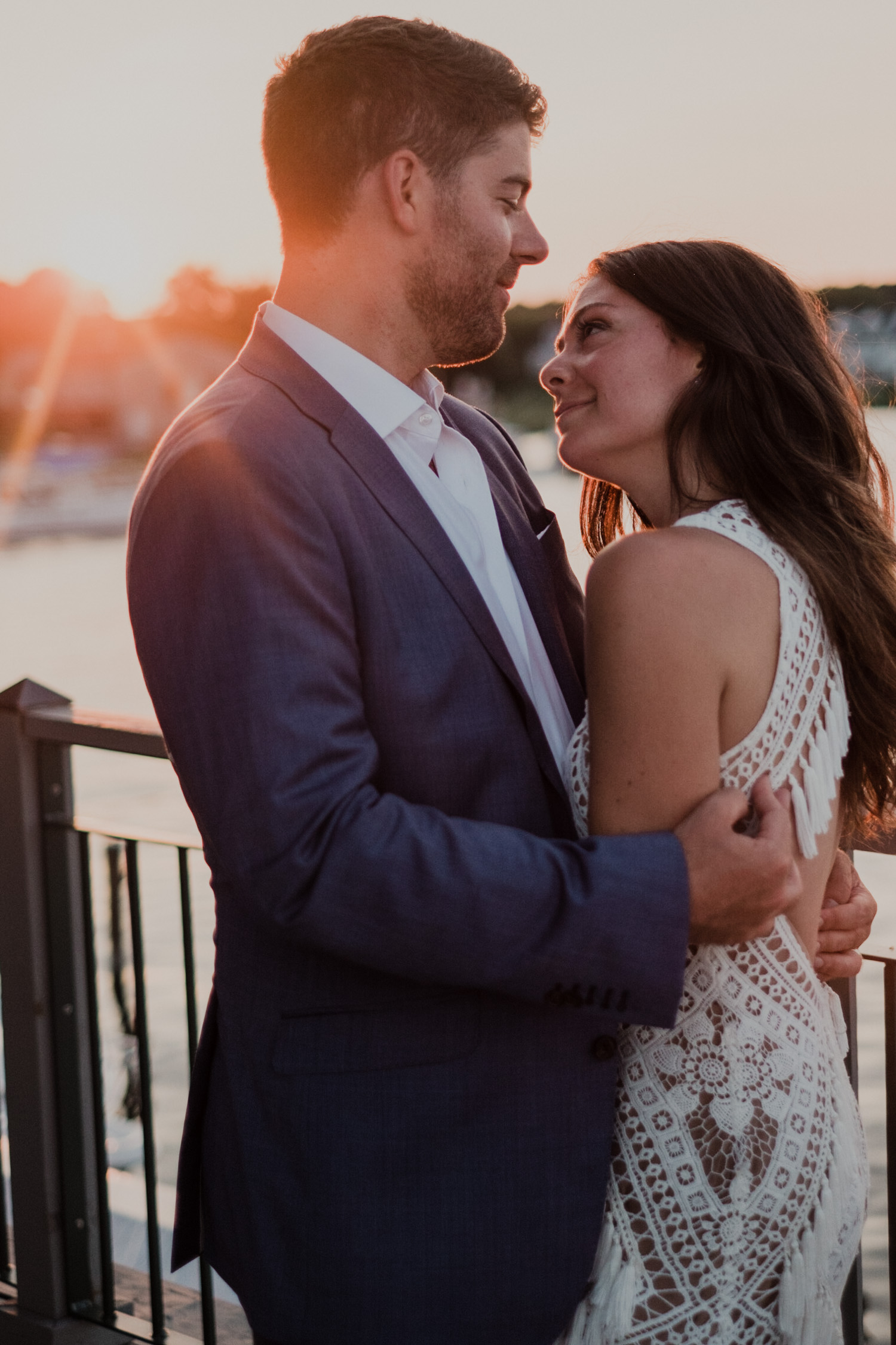 bride and groom looking at each other during sunset portraits