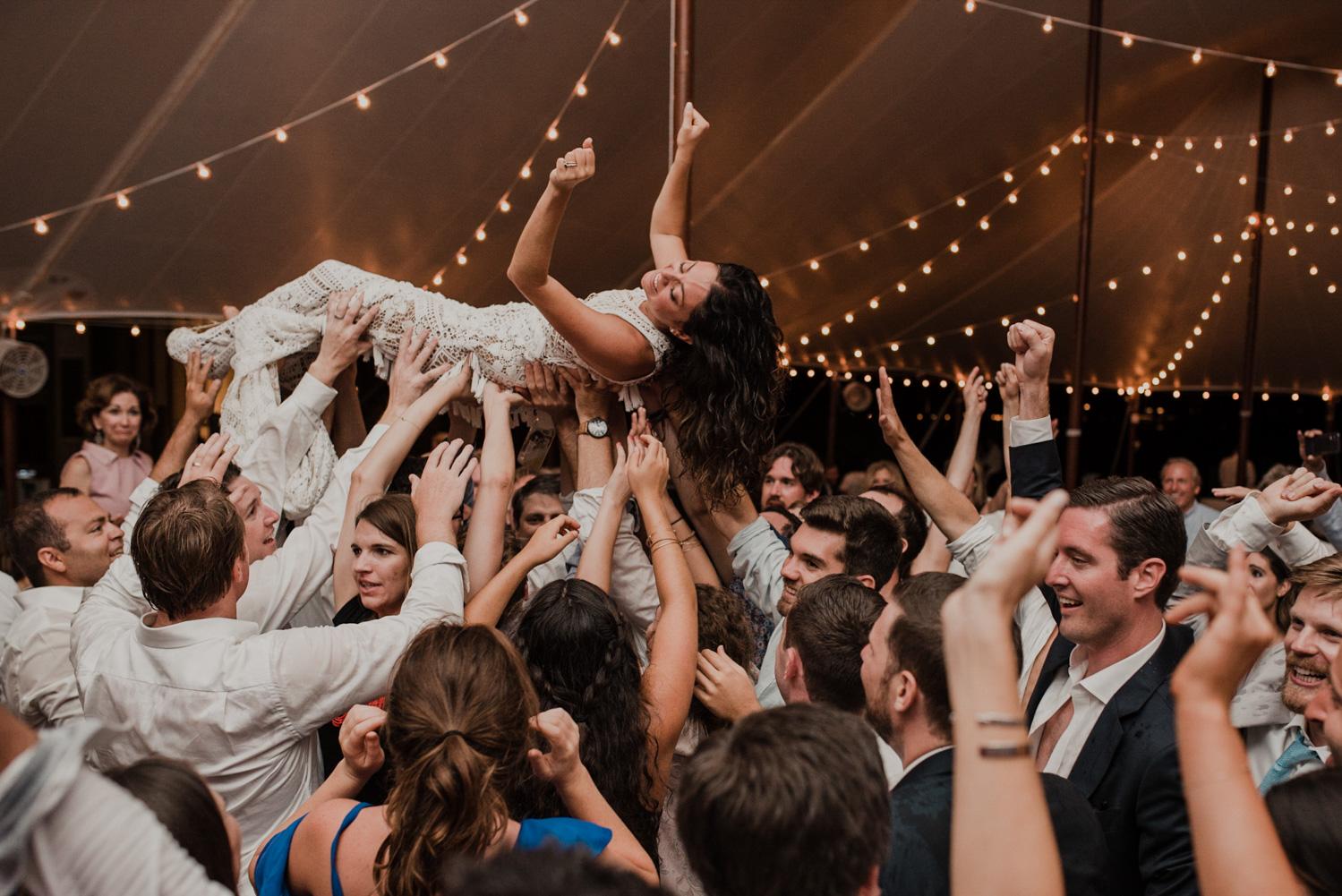 bride crowd surfs during reception at st michaels wedding