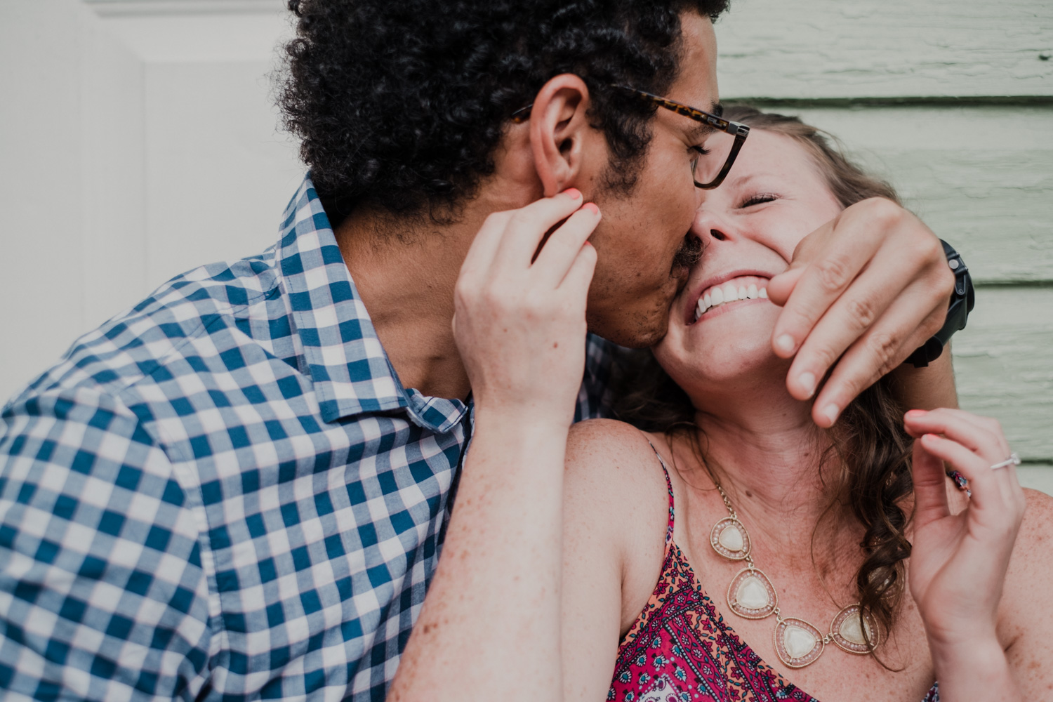 guy goes in for a slobbery face kiss during engagement session