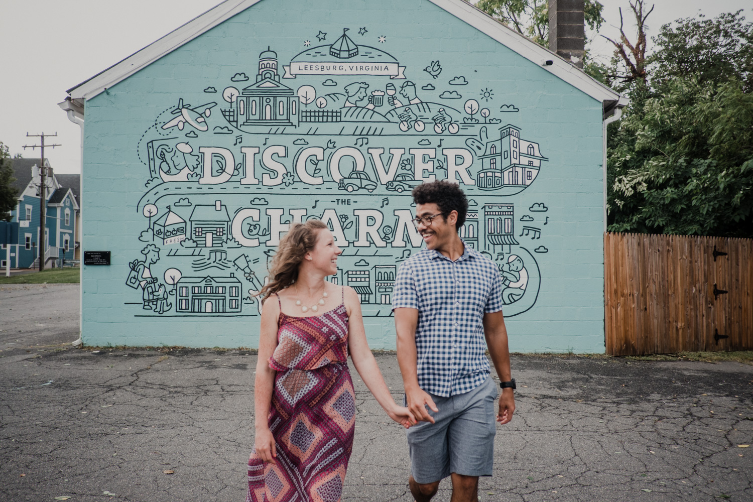 Couple walks away from the Leesburg Discover The Charm mural