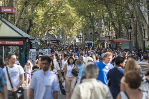 large group of people at market in barcelona spain