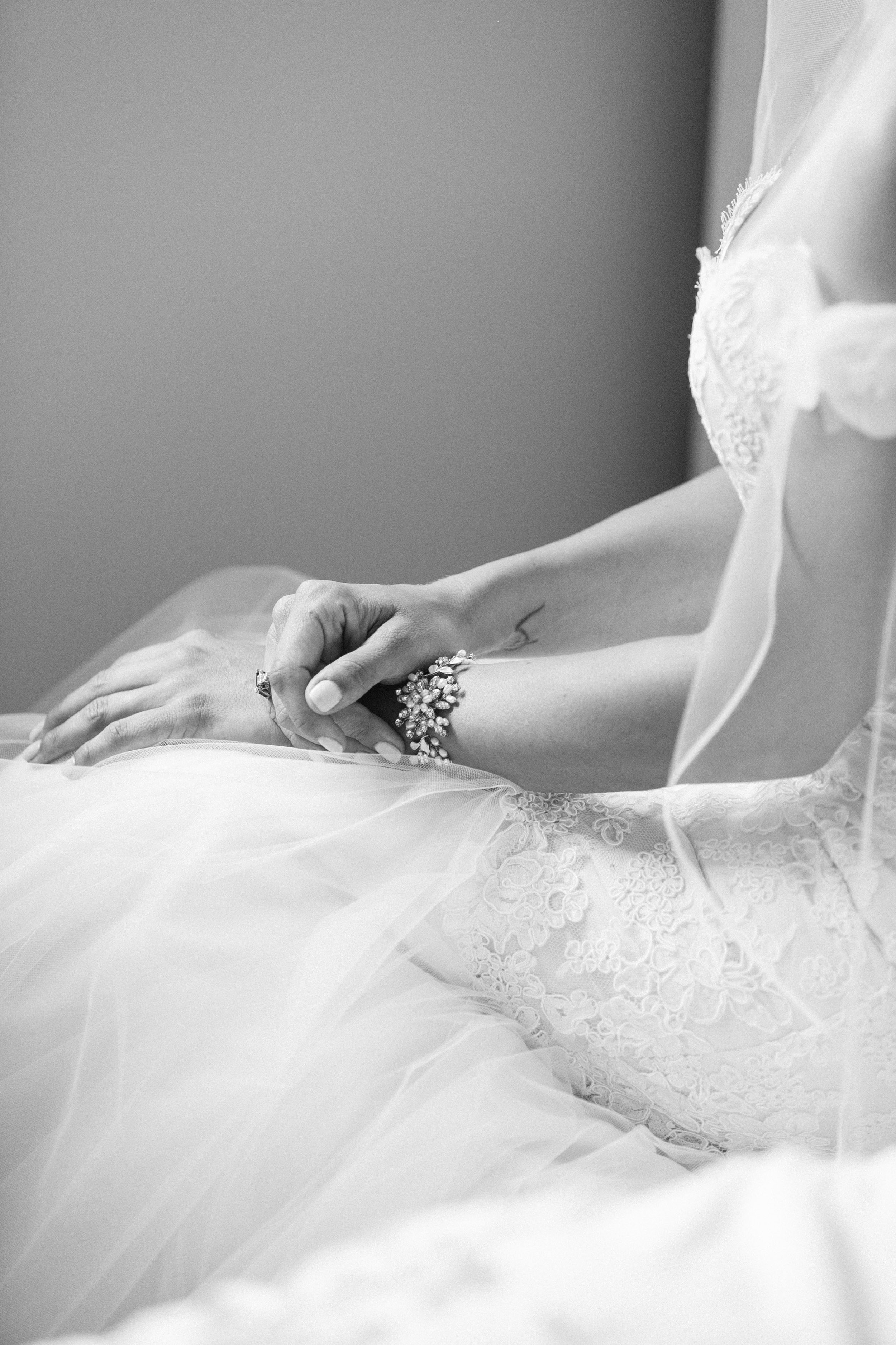 Bride wearing custom bracelet and ring