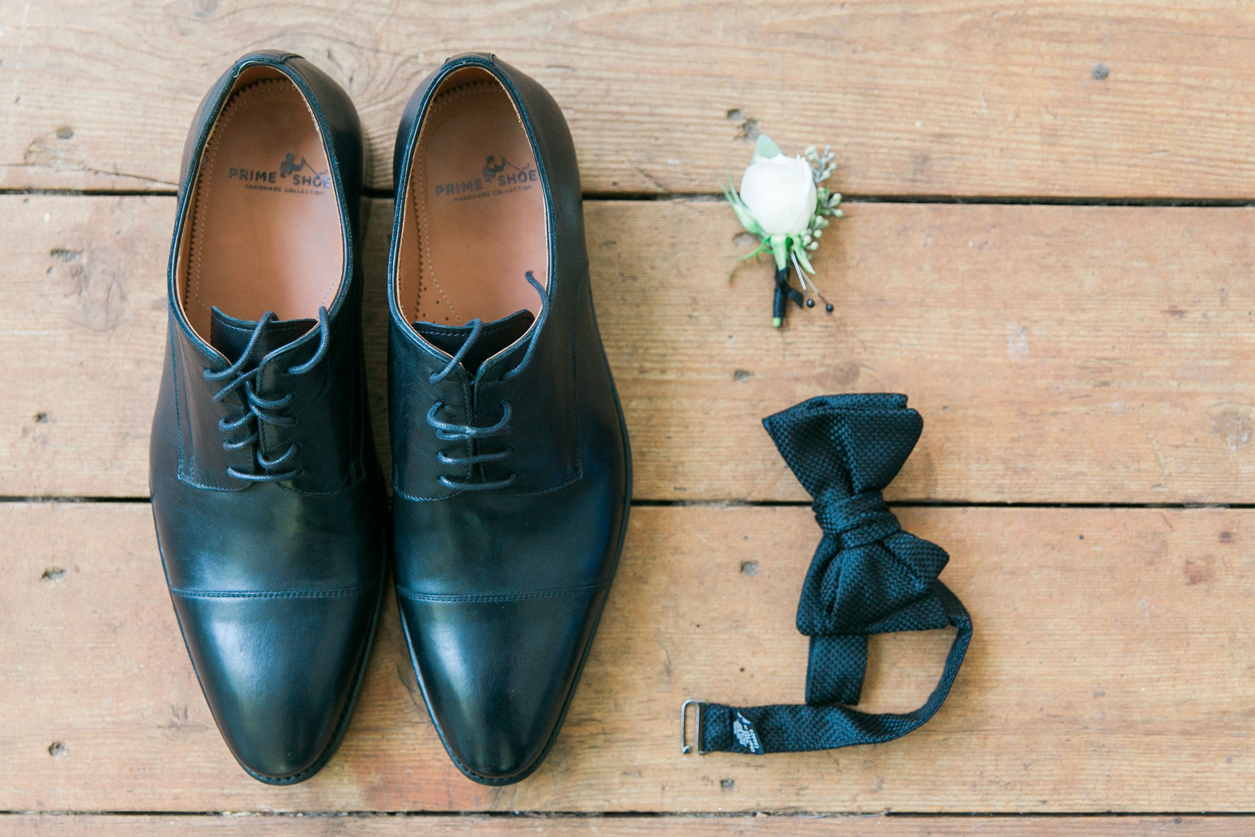Groom's shoes, bow tie and boutiennere